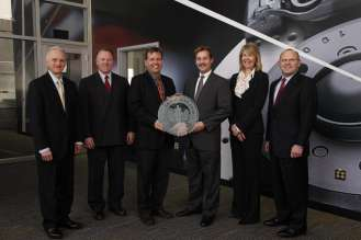 BMW NA's Larry Demski, Wes Neal, and Craig Arnold accepted the LEED award from ProLogis' Greg Arnold, Meg Buffington, and Greg Bauer (left to right) at the Regional Distribution Center (RDC) in Lower Nazareth, PA on February 16, 2010.  Two of BMW NA's RDC's have received LEED certifications from the United States Green Building Council (USGBC). (02/2010)