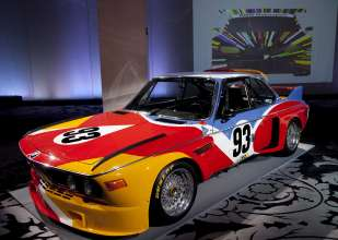 The Alexander Calder BMW Art Car at a news conference in New York where BMW announced it's return to the Le Mans 24 hour race on Tuesday, April 6, 2010. The next BMW Art Car artist Jeff Koons design concept for the 17th BMW Art Car in background. (Jim Sulley/newscast) (04/2010)
