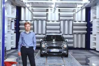 Dr. Robert Liebing, Acoustics engineer, and the MINI with Active Sound Design in the BMW Group Acoustics test bench (05/2010)