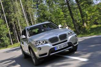 Olympic Luge Champion Georg Hackl tests the new BMW X3. (07/2010