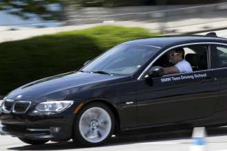 Students get behind the wheel of a new BMW 3 Series with professional driving instructors in the vehicles giving immediate feedback on 