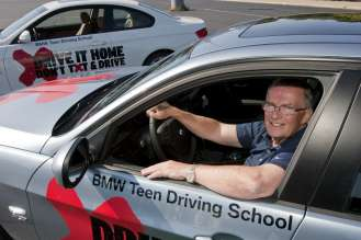 Jim O'Donnell, President of BMW of North America, LLC at the Teen Driving School kicking off the BMW Championship at U.S. Cellular Field in Chicago, IL (9/2010).