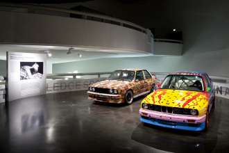 BMW Art Car exhibition at the BMW Museum, October 6, 2010 to June 30, 2011. Michael Jagamara Nelson, Art Car, 1989 - BMW M3 group A racing version [left] and Ken Done, Art Car, 1989 - BMW M3 group A racing version. (10/2010)