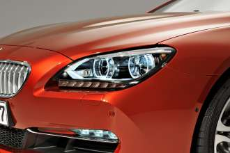 The new BMW 6 Series Coupe - Exterior, Adaptive LED Headlights for low and high beam, including cornering function, foglamps with LED technology. Lights on (03/2011).