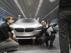 Decision - Nader Faghizadeh (Exterior Designer BMW 6 Series Coupe on the right) and a modeller in front of a BMW 6 Series Coupe model (03/2011).