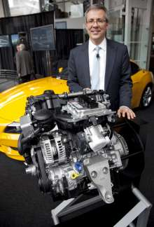 Paul Ferraiolo, Manager, Product Planning & Strategy, BMW NA with the company's new TwinPower Turbo 4-cylinder engine at a news conference in New York on Monday, April 18, 2011. The new BMW Z4 sDrive28i Roadster will be the first model in the U.S. to feature the company's new powerful, efficient and clean 4-cylinder engine. It also marks the return of BMW 4 cylinder power to the United States for the first time in over a decade (Jim Sulley/newscast). (04/2011)