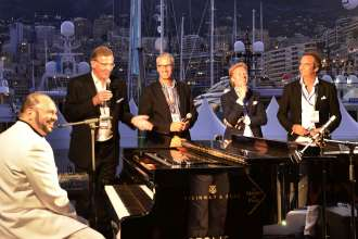 "BMW at the Monaco Yacht Show: On board of the Edmiston Yacht ""Papi du Papi"" (from right to left) yacht owner, Jamie Edmiston, Bernd Doepke (BMW), Hans-Heinrich Schalkowski (Steinway & Sons), Entertainer Marc Masconi"