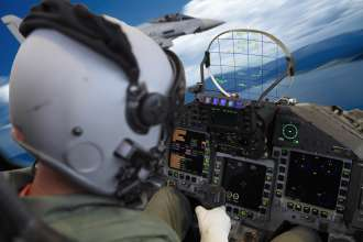 Test pilot Robert Hierl in front of the Head-Up Display in the cockpit of his Eurofighter (10/2011)