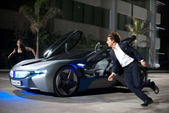 Paula Patton and Tom Cruise with the BMW Vision EfficientDynamics in the movie Mission: Impossible - Ghost Protocol. (11/2011)