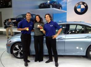 U.S. Olympians Bryan Clay, left, Janet Evans and Apolo Anton Ohno, right, were on hand to help unveil the all-new 2012 BMW 3 Series Sedan at the North American International Auto Show in Detroit, MI on Monday, January 9, 2012. The BMW 3 Series is the world's best selling premium car. Photo distributed by newscast for BMW NA. (01/2012)