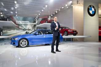 BMW Group Member of the Board of Management Dr. Ian Robertson addresses the media during the BMW press conference at the North American International Auto Show in Detroit on January 9, 2012.  Robertson is pictured in front of the all-new 2012 BMW 3 Series Sedan which made its world debut at the show.