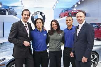 BMW Members of the Board of Management Dr. Klaus Draeger and Dr. Ian Robertson are joined by U.S. Olympians (L to R) Apolo Anton Ohno, Janet Evans and Bryan Clay at the unveiling of the all-new BMW 3 Series Sedan at the North American International Auto Show in Detroit on January 9, 2012.