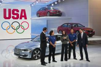 U.S. Olympian and gold medalist, swimmer Janet Evans, addresses the media at the BMW press conference at the North American International Auto Show in Detroit on January 9, 2012.  [(L to R) BMW Member of the Board of Management Dr. Klaus Draeger U.S. Olympians Apolo Anton Ohno, Janet Evans and Bryan Clay and BMW Member of the Board of Management Dr. Ian Robertson].