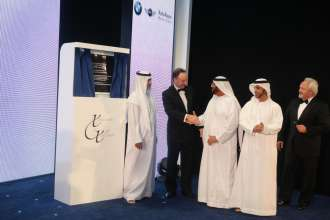 Dr. Ian Robertson, Member of the Board of Management for Sales and Marketing, BMW AG congratulates Sheikh Saif Bin Mohammed Bin Butti Al Hamid, Vice Chairman of Abu Dhabi Motors, Sheikh Nahyan Bin Mubarak Al Nahyan, Minister of Higher Education and Scientific Research, Sheikh Mohammed bin Butti Al Hamid, Chairman of Abu Dhabi Motors and Arno Husselmann, General Manager of Abu Dhabi Motors at the opening of the Abu Dhabi Motors showroom (02/2012)