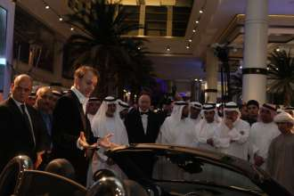 Adrian van Hooydonk, Vice President BMW Group Design introduces the MINI Roadster to guests at the Abu Dhabi Motors showroom opening (02/2012)
