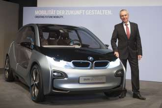 Dr. Friedrich Eichiner, Member of the Board of Management of BMW AG, Finance, next to the BMW i3 Concept. BMW Group Annual Accounts Press Conference in Munich on 13 March 2012 (03/2012)