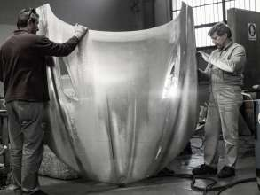 Craftsmen working on the handcrafted aluminum bonnet of the BMW Zagato Coupé in Turin (05/2012)