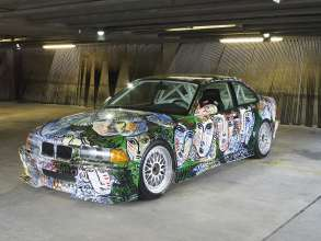 """ART DRIVE! The BMW Art Car Collection 1975-2010"" in London, July 21 - August 4, 2012. Sandro Chia, BMW Art Car, 1992 - BMW 3 Series saloon-car racing prototype."