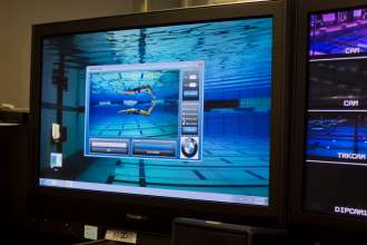 Results of a swimmers dolphin kicks are measured and displayed by BMWs motion tracking system. (08/2012)