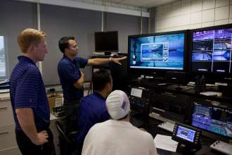 BMW engineer Cris Pavloff reviews and explains results of a swimmer's dolphin kicks with USA Swimming's Russell Mark and Matt Barbin. (08/2012)
