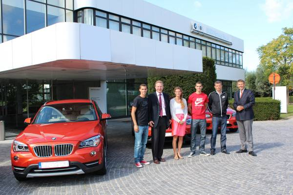 the borl u00e9e family poses in front of the new bmw x1 with bmw belux sales director christian