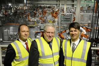 MINI Plant Oxford, 28 March 2013. Frank Bachmann, Managing Director MINI Plant Oxford and Swindon, the Rt Hon Patrick McLoughlin MP, Secretary of State for Transport and Harald Krüger, Member of the Board of Management of BMW AG, with some of the 1,000 new robots which have been commissioned as part of BMW Group's £750m UK investment for the next generation MINI.