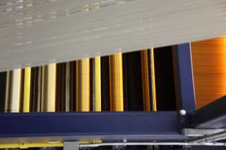 BMW i Production Moses Lake: View into the oxidation portion of the carbon fiber production. White Precursor and different colors of oxidized fiber (09/2013)