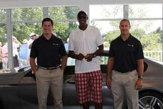 Team USA Bobsledders Steve Langton (right) and Curt Tomasevicz (left) with former Chicago Bulls All-Star Scottie Pippen at the BMW 18th Hole Pavilion on Thursday, September 12 at the 2013 BMW Championship in Lake Forest, IL. (Photo by Ian Yelton/WGA Photo)