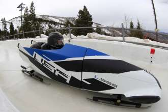 US bobsledders Justin Olsen (left) and John Napier (right) test BMW's first two-man bobsled prototype at the Utah Olympic Park in Park City, UT on March 16, 2012. (Photo, Getty Images)