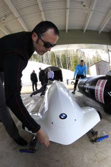 Michael Scully, BMW designer of the two-man bobsled, inspects the first prototype sled at the Utah Olympic Park in Park City, UT on March 15, 2012. (Photo, Getty Images)