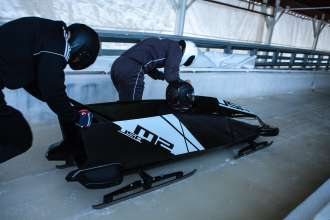 US bobsledders Steven Holcomb (seated), Justin Olsen (front) and the breakman (back) test BMW's second two-man bobsled prototype at the Olympic Sports Complex at Mt. Van Hoevenberg in Lake Placid, NY. December 20, 2012. (Photo, Todd Bissonette)