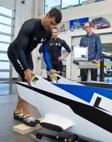 US bobsledder Chuck Berkeley visits BMW Group's DesignWorks USA studio in Newbury Park, CA for a fitting in BMW's first prototype two-man bobsled, while teammate, Cory Butner, and design modeler, Eric Bauer, observe on March 10, 2012. (Photo, Darren Yasukochi).