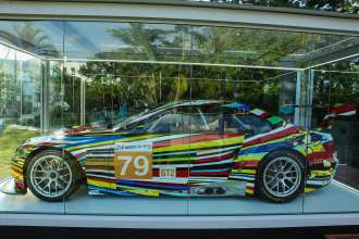 MIAMI BEACH, FL - DECEMBER 04: BMW Art Car by Jeff Koons (BMW M3 GT2) on display on December 4, 2013 in Miami Beach, Florida. (Photo by Donald Bowers/Getty Images for BMW)