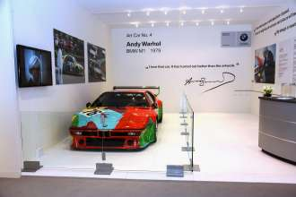 MIAMI BEACH, FL - DECEMBER 04: BMW Art Car by Andy Warhol, 1979 BMW M1 on display at the VIP lounge at Art Basel Miami Beach on December 4, 2013 in Miami Beach, Florida. (Photo by Donald Bowers/Getty Images for BMW)