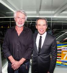 MIAMI BEACH, FL - DECEMBER 04: (L-R)Chris Dercon, Director of London's Tate Modern and Jeff Koons unveil the North American premiere of the BMW Art Car by Jeff Koons (BMW M3 GT2) on Wednesday, December 4, 2013 in the Miami Beach Botanical Gardens as part of Art Basel Miami Beach 2013. (Photo by Donald Bowers/Getty Images for BMW)