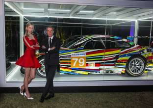 MIAMI BEACH, FL - DECEMBER 04: (L-R) Supermodel and actress Karolína Kurková and artist Jeff Koons unveil the North American premiere of the BMW Art Car by Jeff Koons (BMW M3 GT2) in the Miami Beach Botanical Gardens as part of Art Basel on December 4, 2013 in Miami Beach, Florida. (Photo by Donald Bowers/Getty Images for BMW)