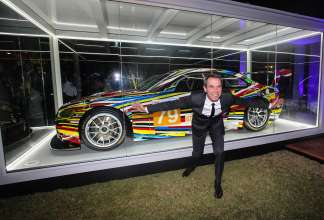 MIAMI BEACH, FL - DECEMBER 04: Artist Jeff Koons unveils the North American premiere of his BMW Art Car (BMW M3 GT2) in the Miami Beach Botanical Gardens as part of Art Basel on December 4, 2013 in Miami Beach, Florida. (Photo by Donald Bowers/Getty Images for BMW)