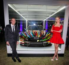 MIAMI BEACH, FL - DECEMBER 04: (L-R) Artist Jeff Koons and supermodel and actress Karolína Kurková unveil the North American premiere of the BMW Art Car by Jeff Koons (BMW M3 GT2) in the Miami Beach Botanical Gardens as part of Art Basel on December 4, 2013 in Miami Beach, Florida. (Photo by Donald Bowers/Getty Images for BMW)