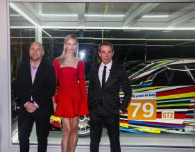MIAMI BEACH, FL - DECEMBER 04: (L-R) Mark Spiegler, supermodel and actress Karolína Kurková and Jeff Koons unveil the North American premiere of the BMW Art Car by Jeff Koons (BMW M3 GT2) in the Miami Beach Botanical Gardens as part of Art Basel on December 4, 2013 in Miami Beach, Florida. (Photo by Donald Bowers/Getty Images for BMW)