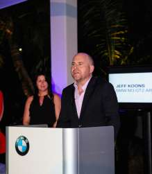 MIAMI BEACH, FL - DECEMBER 04: (L-R)Trudy Hardy and Marc Spiegler unveil the North American premiere of the BMW Art Car by Jeff Koons (BMW M3 GT2) in the Miami Beach Botanical Gardens as part of Art Basel on December 4, 2013 in Miami Beach, Florida. (Photo by Donald Bowers/Getty Images for BMW)
