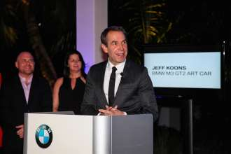 MIAMI BEACH, FL - DECEMBER 04: (L-R)Marc Spiegler, Trudy Hardy and Jeff Koons unveil the North American premiere of the BMW Art Car by Jeff Koons (BMW M3 GT2) in the Miami Beach Botanical Gardens as part of Art Basel on December 4, 2013 in Miami Beach, Florida. (Photo by Donald Bowers/Getty Images for BMW)