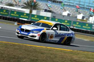 BMW privateer racers practice for the third-annual BMW Performance 200 race at Daytona International Speedway. 22 January 2014.