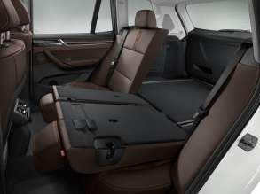 The new BMW X3 - Interior, Nevada leather Mocha - Interior trim, Fineline Anthracite wood with Pearl-gloss Chrome accent line - Rear seat bench - xLine (02/2014).