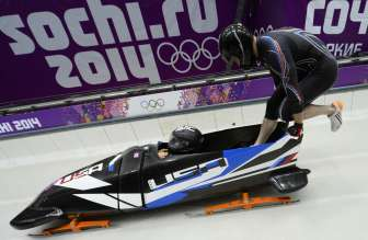 USA-1 two-man bobsleigh pilot Steven Holcomb and brakeman Steven Langton take the start of the Bobsleigh Two-man Heat 3 at the Sliding Center Sanki during the Sochi Winter Olympics on February 17, 2014. AFP PHOTO / LIONEL BONAVENTURE (Photo credit should read LIONEL BONAVENTURE/AFP/Getty Images)