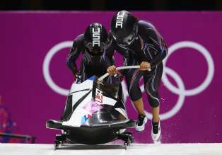 SOCHI, RUSSIA - FEBRUARY 18:  Elana Meyers and Lauryn Williams of the United States team 1 make a run during the Women's Bobsleigh heats on day 11 of the Sochi 2014 Winter Olympics at Sliding Center Sanki on February 18, 2014 in Sochi, Russia.  (Photo by Julian Finney/Getty Images)