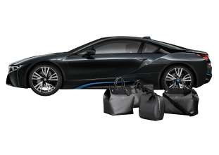 "The tailor-made Louis Vuitton luggage set for the BMW i8 made from carbon fibre: small ""Weekender PM i8"", big ""Weekender GM i8"", hardshell  ""Business Case i8"", ""Garment Bag i8"". (02/2014)"
