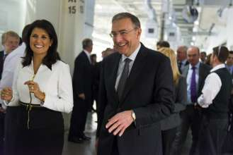 The Honorable Nikki Haley, Governor of South Carolina, and Dr. Norbert Reithofer, Chairman of the Board of Management, BMW Group celebrate BMW's announcement of an additional $1 Billion investment in the South Carolina plant. (03/2014)