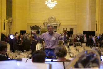 Albert Osterhammer conducts the Munich Philharmonic Orchestra during a public rehearsal for a BMW concert in Grand Central Terminal in New York City on Thursday, April 10, 2014.