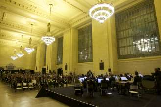 The Munich Philharmonic Orchestra performs at a BMW concert in Grand Central Terminal in New York City on Thursday, April 10, 2014.