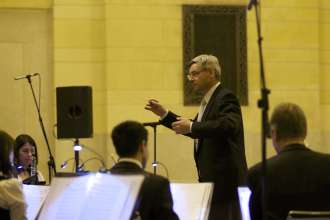 Albert Osterhammer conducts the Munich Philharmonic Orchestra at a BMW concert in Grand Central Terminal in New York City on Thursday, April 10, 2014.